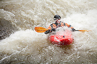 Kayaker descending the rapids on the New Haven River outside Bristol, VT.