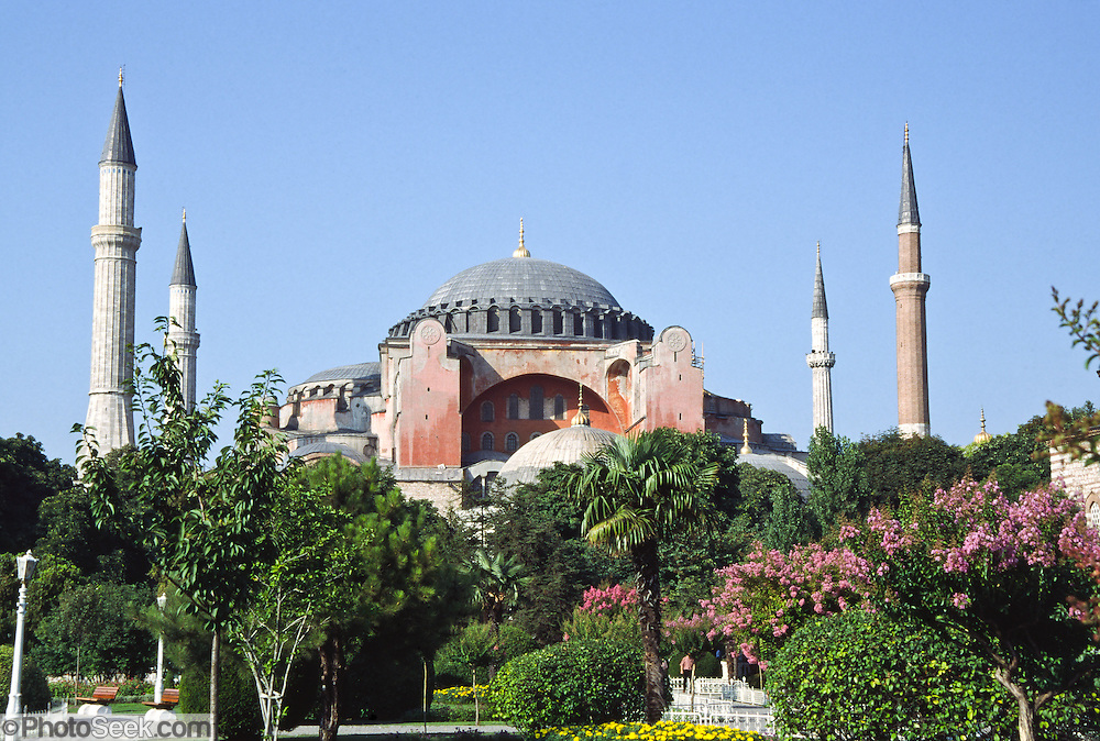 """Aya Sofya Museum in İstanbul, Turkey. In Greek, it's called Hagia Sofia, or Sancta Sophia in Latin, which means """"Divine Wisdom."""" The minarets were constructed after the Islamic conquest of 1453. Emperor Justinian built the Hagia Sofia from 532 to 537 AD in Constantinople on the site of a former Hagia Sofia on the acropolis of the former Byzantium. The 102-foot diameter dome perches an amazing 180 feet above the floor (rivalling the scale of the 144-foot high and wide concrete dome of Rome's Pantheon, built earlier from 118-125 AD). An earthquake collapsed the dome after only 22 years, and it was rebuilt several times by later Byzantine emperors and Ottoman sultans. 30 million gold mosaic tiles covered the dome's interior in Byzantine times. Hagia Sofia reigned as the greatest church in Christendom for nearly 1000 years, until the Islamic conquest of Constantinople by Mehmet the Conqueror in 1453. A church with a larger dome, St. Peter's Basilica in Rome, was not built until 1506. Hagia Sofia served as a mosque from 1453 to 1935, after which Atatürk, the father of the modern Republic of Turkey, declared it a museum. İstanbul's Hagia Sofia still stands as one of the architectural marvels of the world."""