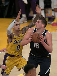 October 25, 2018 - Los Angeles, California, U.S - Nikola Jokic #15 of the Denver Nuggets goes for a shot past Kyle Kuzma #0 of the Los Angeles Lakers  during their NBA game on Thursday October 25, 2018 at the Staples Center in Los Angeles, California. Lakers defeat Nuggets, 121-114. (Credit Image: © Prensa Internacional via ZUMA Wire)
