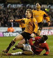 Photo: Glyn Thomas.<br />Wolverhampton Wanderers v Manchester United. The FA Cup. 29/01/2006.<br /> United's Louis Saha (bottom) scores his team's second goal.