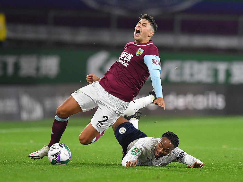 Burnley's Matthew Lowton is fouled by  Manchester City's Raheem Sterling<br /> <br /> Photographer Dave Howarth/CameraSport<br /> <br /> Carabao Cup Fourth Round - Burnley v Manchester City - Wednesday 30th September 2020 - Turf Moor - Burnley<br />  <br /> World Copyright © 2020 CameraSport. All rights reserved. 43 Linden Ave. Countesthorpe. Leicester. England. LE8 5PG - Tel: +44 (0) 116 277 4147 - admin@camerasport.com - www.camerasport.com