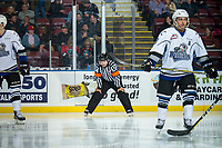KELOWNA, CANADA - OCTOBER 5:  Referee Chris Crich stands on the ice between the Kelowna Rockets and the Victoria Royals on October 5, 2018 at Prospera Place in Kelowna, British Columbia, Canada.  (Photo by Marissa Baecker/Shoot the Breeze)  *** Local Caption ***