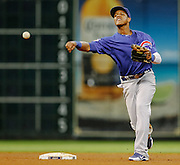 May 23, 2012; Houston, TX, USA; Chicago Cubs shortstop Starlin Castro (13) throws out a runner against the Houston Astros during the fourth inning at Minute Maid Park. Mandatory Credit: Thomas Campbell-US PRESSWIRE