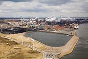 Nederland, Noord-Holland, Velsen, 16-04-2008; windmolens bij het slibdepot voor (zout en vervuld) baggerslib; in de achtergrond het terrein van Corus en met rechts de buitenhaven met de opslag voor erts, kolen, cokes; het complex ligt in Velsen-Noord, naast de sluizen van het Noordzee kanaal (tegenover IJmuiden); Corus: voorheen Hoogovens gefuseerd met British Steel; slibdepot, bagger, slib, baggeren, depot..luchtfoto (toeslag); aerial photo (additional fee required); .foto Siebe Swart / photo Siebe Swart