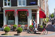 Cyclist in Keizersgracht in the Nine Streets - De Negen Straatjes - 9 Streets district of Jordaan, Amsterdam