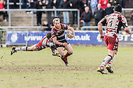 Sarel Pretorius of the Newport Gwent Dragons makes his run but is caught by Sam Hidalgo-Clyne of Edinburgh rugby, Guinness Pro12 rugby match, Newport Gwent Dragons v Edinburgh Rugby at Rodney Parade in Newport, South Wales on Sunday 27th March 2016.<br /> pic by  Simon Latham, Andrew Orchard sports photography.
