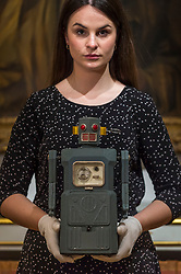 "© Licensed to London News Pictures. 19/03/2021. LONDON, UK. A staff member presents a ""rare TM (Masudaya) battery-operated Radicon Robot, 1957"" (est. £4,000-6,000).  Preview of the upcoming sale of property from the collection of the Patricia Knatchbull, 2nd Countess Mountbatten of Burma.  Over 350 lots spanning jewellery, furniture, paintings, sculpture, books, silver, ceramics & objets d'art are to be auctioned on 24 March at Sotheby's New Bond Street galleries.  Photo credit: Stephen Chung/LNP"