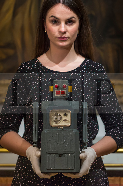 """© Licensed to London News Pictures. 19/03/2021. LONDON, UK. A staff member presents a """"rare TM (Masudaya) battery-operated Radicon Robot, 1957"""" (est. £4,000-6,000).  Preview of the upcoming sale of property from the collection of the Patricia Knatchbull, 2nd Countess Mountbatten of Burma.  Over 350 lots spanning jewellery, furniture, paintings, sculpture, books, silver, ceramics & objets d'art are to be auctioned on 24 March at Sotheby's New Bond Street galleries.  Photo credit: Stephen Chung/LNP"""