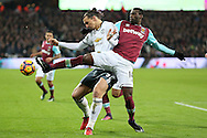 Pedro Mba Obiang of West Ham United challenges Zlatan Ibrahimovic of Manchester United. Premier league match, West Ham Utd v Manchester Utd at the London Stadium, Queen Elizabeth Olympic Park in London on Monday 2nd January 2017.<br /> pic by John Patrick Fletcher, Andrew Orchard sports photography.