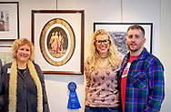 "Manhasset, New York, U.S., February 1, 2020. L-R, ANN PARRY, LAURIE GRAB, and JOE CESTARE stand next to Parry's photograph ""The Three Graces"" which won First Place, at Reception for The Art Guild exhibition ""Everything Old is New Again"" held at Elderfields Preserve. Photographer captured photographs of dancers from the Lori Belilove and the Isadora Duncan Dance Company during their performance at Old Westbury Gardens."