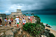 MEXICO, MAYAN, YUCATAN Tulum; tourists at 'El Castillo'