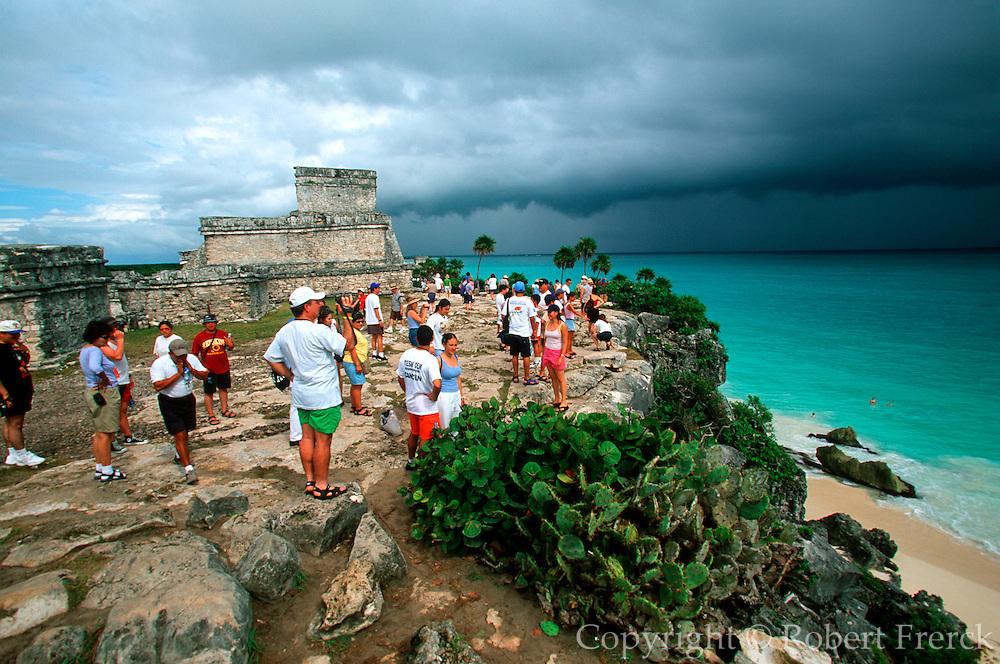 MEXICO, MAYAN, YUCATAN Tulum; tourists at 'El Castillo'