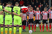 Lincoln City and Exeter City players prior to  the EFL Sky Bet League 2 match between Lincoln City and Exeter City at Sincil Bank, Lincoln, United Kingdom on 30 March 2018. Picture by Mick Atkins.