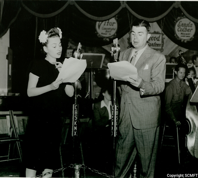 1944 Ken Murray & Olivia de Havilland entertain the soldiers at the Hollywood Canteen