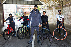 """Left to right, Trizzy, 16, Liam Ross, 17, Mac Ferrari with his dog Xuki, Tevon 'TJ Jules, 13, and Pharell """"PJ"""" Samuel, 16. Bikestormz is the brainchild of leader Mac Ferrari, a group of young trick cyclists who are encouraged to put knives down and enjoy the healthy, positive side of urban youth culture by joining together  and developing their cycling skills. London, September 27 2019."""