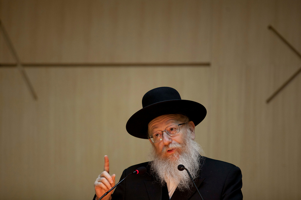 """Deputy Minister of Health Yaakov Litzman speaks during the """"Shield of the Ministry of Health to outstanding volunteers"""" award ceremony at the Knesset, Israel's parliament in Jerusalem, on January 3, 2012."""