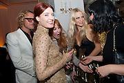 PETER DUNDAS; FLORENCE WELCH; POPPY DELEVIGNE;  Harper's Bazaar Women Of the Year Awards 2011. Claridges. Brook St. London. 8 November 2011. <br /> <br />  , -DO NOT ARCHIVE-© Copyright Photograph by Dafydd Jones. 248 Clapham Rd. London SW9 0PZ. Tel 0207 820 0771. www.dafjones.com.