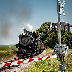 Strasburg, PA, USA - June 21, 2013: A Strasburg Rail Road steam locomotive rolls down the tracks in rural Lancaster County.