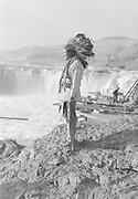 9305-B7367-2. Henry Thompson at Celilo Falls. September, 1938