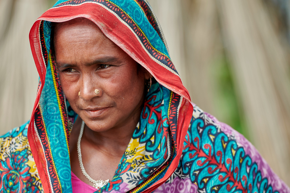 A woman in Kunderpara, a village on an island in the Brahmaputra River in northern Bangladesh.