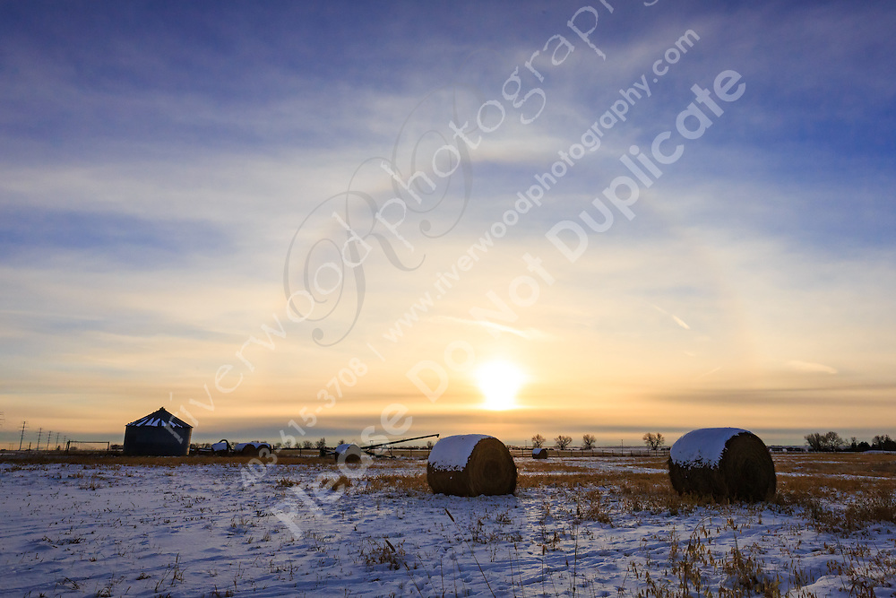 A glowing halo around the sun on an icy cold day in winter.<br /> <br /> ©2015, Sean Phillips<br /> http://www.RiverwoodPhotography.com