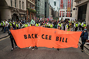 Environmental activists from Extinction Rebellion march behind a Back CEE Bill banner during an Impossible Tea Party event in the City of London on 30th August 2021 in London, United Kingdom. Extinction Rebellion were drawing attention to financial institutions funding fossil fuel projects whilst calling on the UK government to cease all new fossil fuel investment with immediate effect on the eighth day of their Impossible Rebellion protests in London.