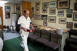Embargoed to 0001 Monday August 28 A player fills a dog bowl with fresh water during the tea break at the annual friendly match between Cravens Cavaliers and Lynton & Lynmouth Cricket Club at the ground based inside the Valley of Rocks, North Devon, on Saturday August 5th, 2017.
