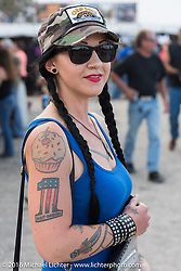 Casey Detrick with her new Sportster seat she picked up at Sopotnicks Cabbage Patch Bar, New Smyrna Beach, during Daytona Bike Week's 75th Anniversary event. FL, USA. Saturday March 12, 2016.  Photography ©2016 Michael Lichter.