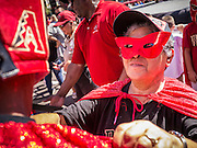 16 SEPTEMBER 2012 - PHOENIX, AZ:  A woman in a home made Lucha Libra wrestling outfit in front of Chase Field. The Arizona Diamondbacks hosted their 14th Annual Hispanic Heritage Day, Sunday to kick off Hispanic Heritage Month (Sept. 15-Oct. 15) before the 1:10 p.m. game between the D-backs and San Francisco Giants. The main attraction of the Day was three Lucha Libre USA exhibition wrestling matches in front of Chase Field stadium before the game. PHOTO BY JACK KURTZ