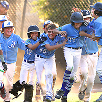 The Aptos 10-11 Little League All-Stars mob Morgan Schaefer (77) as he crosses the plate after hitting a walk-off 3-run homerun in the bottom of the sixth inning to win the Section 5 Championship at Baggerly Park in Los Gatos, California to advance to the California State Tournament.<br /> Photo by Shmuel Thaler <br /> shmuel_thaler@yahoo.com www.shmuelthaler.com