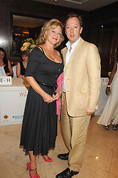 KAY SAATCHI and GEORDIE GREIG at a party to celebrate the 180th Anniversary of The Spectator magazine, held at the Hyatt Regency London - The Churchill, 30 Portman Square, London on 7th May 2008.<br /><br />NON EXCLUSIVE - WORLD RIGHTS