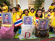 05 DECEMBER 2014 - BANGKOK, THAILAND: Thais line the street in front of Siriraj Hospital hoping to see Bhumibol Adulyadej, the King of Thailand, on his birthday. Thais marked the 87th birthday  the King Friday. The revered Monarch was scheduled to make a rare public appearance in the Grand Palace but cancelled at the last minute on the instructions of his doctors. He has been hospitalized in Siriraj Hospital, across the Chao Phraya River from the Palace, since early October.    PHOTO BY JACK KURTZ