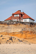 House on cliff top subsequently demolished in March 2011 because of coastal erosion, Easton Bavents, Suffolk, England