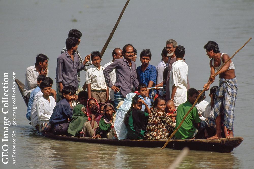 A photograph of of a ferry boat on the Sitalakhya River (in the NGM called the Lakhya River).