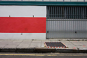 Red striped theme in empty urban pavement landscape.