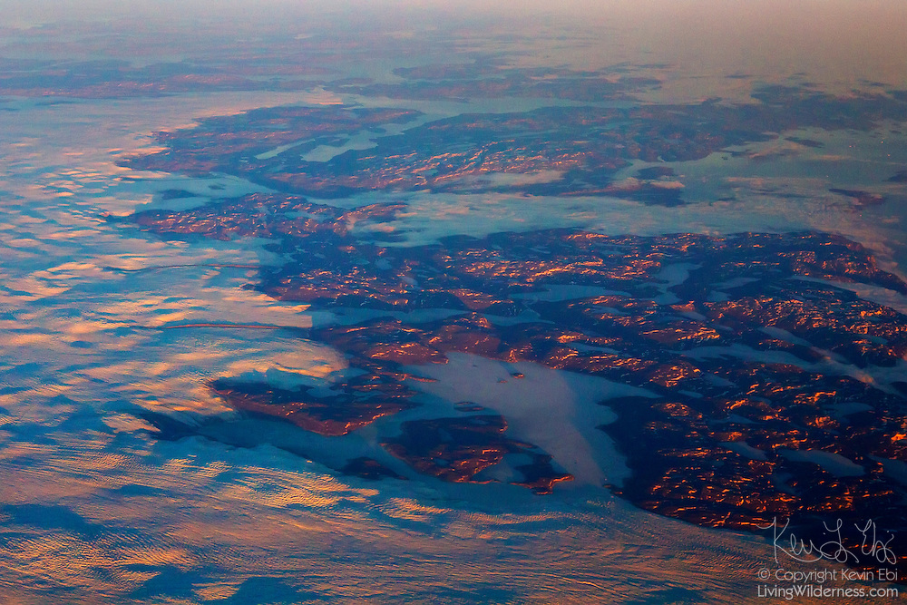 The large Sarqardliup Sermia glacier is visible in the foreground flowing from the Greenland icecap in this aerial view from the western Greenland coast.