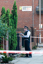 © licensed to London News Pictures. London, UK  30/09/2011. A PCSO on John Feardon Walk in North Kensington, West London where three teenage girls where shot yesterday evening. The victims, aged 17, 18 and 19 are all in serious condition. Photo credit Ben Cawthra/LNP
