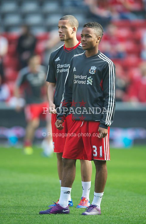 LIVERPOOL, ENGLAND - Saturday, March 24, 2012: Liverpool's substitutes Raheem Sterling and Nathan Eccleston warms up before the Premiership match against Wigan Athletic at Anfield. (Pic by David Rawcliffe/Propaganda)