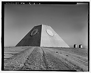 America's pyramid: Photos reveal the Egyptian-esque missile facility used by the U.S. military to detect and launch ICBMs<br /> <br /> Anyone traveling through Nekoma, North Dakota - a stone's throw from the Canadian border on the way to the exact middle of nowhere - might be shocked to find an enormous pyramid jutting above the horizon. As well they should be - this is North Dakota, not Egypt.<br /> But this American pyramid was once home to one of the United States military's anti-ballistic missile defense system with the Cold War-era goal of shooting down Soviet missiles before they ever reached their intended targets - and likely killing thousands of Americans.<br /> The Nekoma pyramid is part of a cluster of military facilities once known as the Stanley R. Mickelsen Safeguard Complex, named after U.S. Army Air Defense Commanding General Stanley Mickelsen.<br /> <br /> Construction of the Complex was completed in 1975. The Complex's pyramid served as its Missile Site Radar base that essentially scanned all directions in search of airborne objects that may pose a threat to the U.S.<br /> The pyramid-shaped radar facility was complete with 30 Spartan missiles and 16 of the shorter-range Sprints missiles, all of which were held in underground launch silos.<br /> The location of the pyramid is cryptically explained as 'Northeast of Tactical Road; southeast of Tactical Road South' - a sparsely populated section of one of the most sparsely populated states in the U.S.<br /> As a whole, the Complex was armed with launch and control pads for 30 LIM-49 Spartan anti-ballistic missiles, and 70 shorter-range Sprint anti-ballistic missiles in support of the Army's Safeguard anti-ballistic missile program.<br /> On February 10, 1976, the site was officially deactivated - after less than a year of being operational.<br /> The Library of Congress, however, has a stunning set of images that shows the various states of construction and completion.<br /> The photos were taken for 