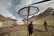 Setting up the yurt's center piece. Kyrgyz are nomads. Ooroon Boi's family, at the summer camp during migration..Daily life at the Khan (chief) summer camp of Kara Jylga...Trekking through the high altitude plateau of the Little Pamir mountains (average 4200 meters) , where the Afghan Kyrgyz community live all year, on the borders of China, Tajikistan and Pakistan.