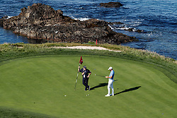June 11, 2019 - Pebble Beach, CA, U.S. - PEBBLE BEACH, CA - JUNE 11: PGA golfer Dustin Johnson gets putting instruction from his coach Butch Harmon on the 7th hole during the practice round for the 2019 US Open on June 11, 2019, at Pebble Beach Golf Links in Pebble Beach, CA. (Photo by Brian Spurlock/Icon Sportswire) (Credit Image: © Brian Spurlock/Icon SMI via ZUMA Press)