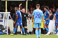 AFC Wimbledon midfielder Liam Trotter (14) receives a yellow card during the EFL Sky Bet League 1 match between AFC Wimbledon and Coventry City at the Cherry Red Records Stadium, Kingston, England on 11 August 2018.