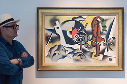 """© Licensed to London News Pictures. 28/06/2018. LONDON, UK. A visitor walks by """"La femme aux clés"""", 1930 by Fernand Léger.  Members of the public visit Masterpiece London, the world's leading cross-collecting art fair held in the grounds of the Royal Hospital Chelsea.  The fair brings together 160 international exhibitors presenting works from antiquity to the present day and runs 28 June to 4 July 2018.  Photo credit: Stephen Chung/LNP"""