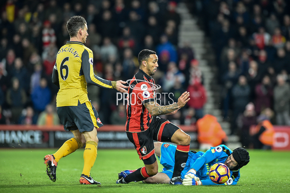 Arsenal Goalkeeper, Petr Cech (33) saves at the feet of AFC Bournemouth Forward, Callum Wilson (13) during the Premier League match between Bournemouth and Arsenal at the Vitality Stadium, Bournemouth, England on 3 January 2017. Photo by Adam Rivers.