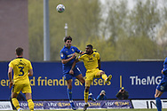 AFC Wimbledon defender Will Nightingale (5) heads the ball under pressure from Oxford United striker Jerome Sinclair (9) during the EFL Sky Bet League 1 match between Oxford United and AFC Wimbledon at the Kassam Stadium, Oxford, England on 13 April 2019.