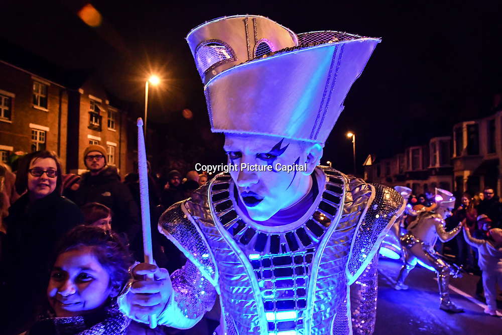 """Local community attends """"Welcome to the Forest"""" with spectacular paraders with a amazing lights dress, drums and gorgrous samba dancers at Forest Road, Walthamstow on 13 January 2019, London, UK."""