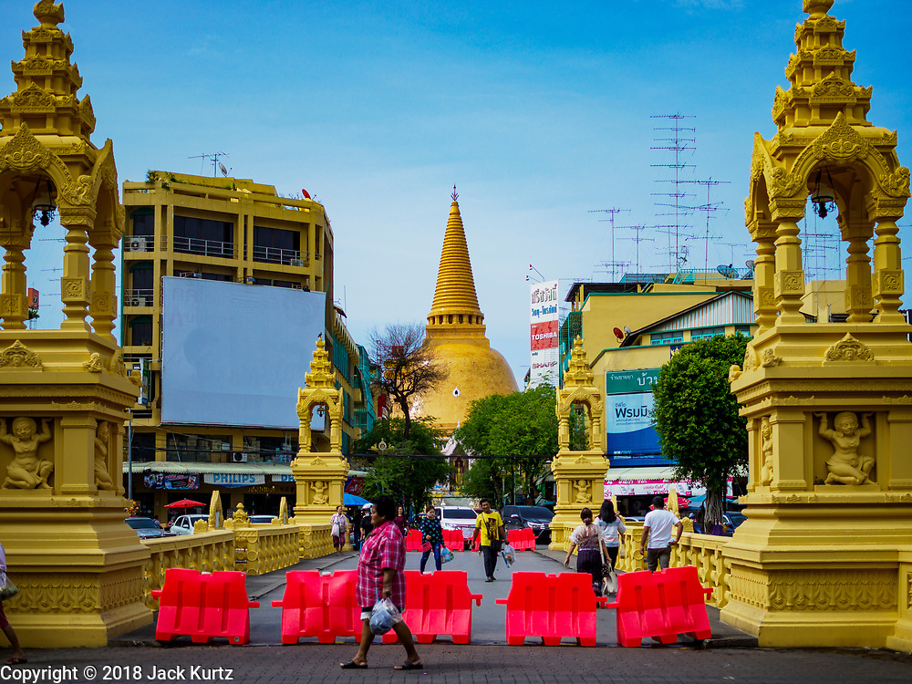 10 JULY 2018 - NAKHON PATHOM, THAILAND:  The Phra Pathom Chedi is the most visible landmark in Nakhon Pathom. Nakhon Pathom is about 35 miles west of Bangkok. It is one of the oldest cities in Thailand, archeological evidence suggests there was a settlement on the site of present Nakhon Pathom in the 6th century CE, centuries before the Siamese empires existed. The city is widely considered the first Buddhist community in Thailand and the nearly 400 foot tall Phra Pathom Chedi is considered the first Buddhist temple in Thailand.    PHOTO BY JACK KURTZ