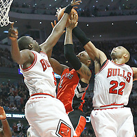 24 March 2012: Toronto Raptors small forward James Johnson (2) is blocked by Chicago Bulls forward Taj Gibson (22) and Chicago Bulls small forward Luol Deng (9) during the Chicago Bulls 102-101 victory in overtime over the Toronto Raptors at the United Center, Chicago, Illinois, USA.