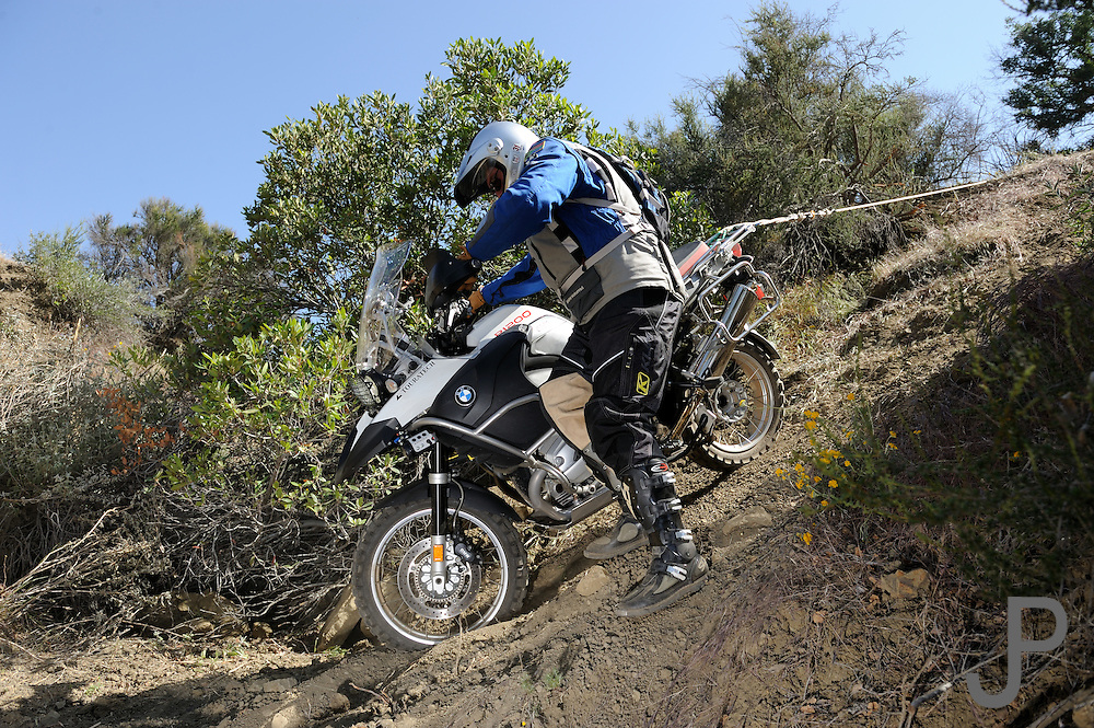 """Rider teams had to use a belay rope to lower their GS style bikes into """"The Pit"""" during competition at the 2009 Rawhyde Adventure Rider Challenge"""