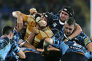 Cardiff Blues v Australia at the Cardiff City Stadium on Tuesday 24th Nov 2009. pic by Andrew Orchard, Andrew Orchard sports photography Scott Morgan of Cardiff Blues gets to grips with Australia's Dean Mumm.